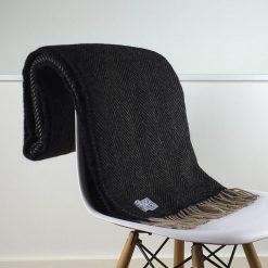 belgravia charcoal grey & beige herringbone blanket folded over front of chair